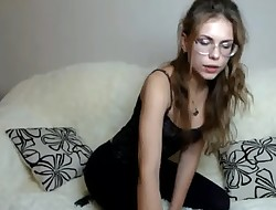 Nerdy looking Teen gets topless & rubs oil on tits